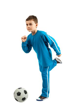 Adorable football kid executing a kick, isolated on white background photo