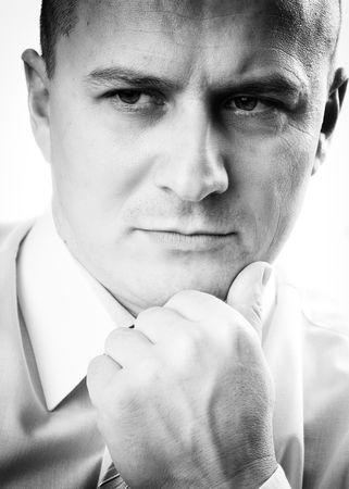 chin on hands: Monochrome stylized portrait of a pensive man