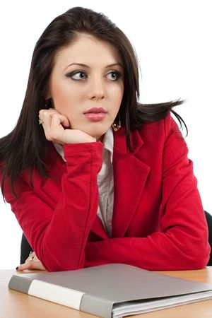 Worried young businesswoman with a folder on her desk photo