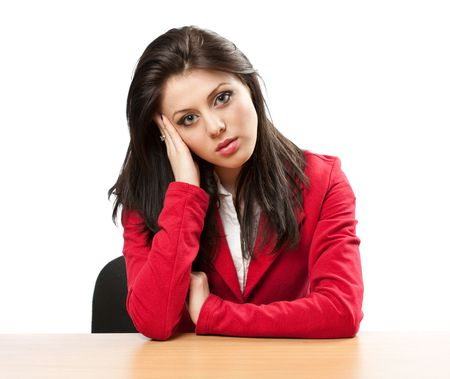 Young businesswoman with migraine sitting at her desk photo