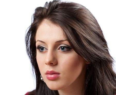 Closeup portrait of a beautiful brunette with blue eyes photo