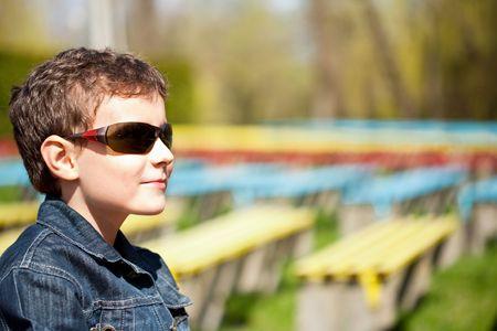 Closeup portrait of a happy schoolboy outdoor photo