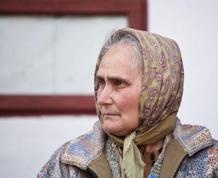 old farmer: Closeup portrait of a sad old woman