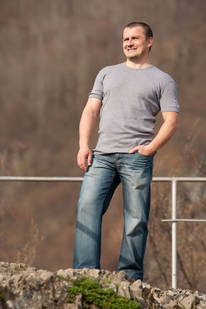 Full length portrait of a young caucasian man outdoors Stock Photo - 6792954