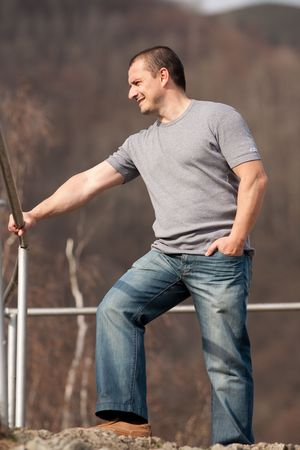 Full length portrait of a young caucasian man outdoors Stock Photo - 6792958