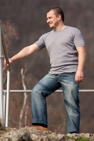 Full length portrait of a young caucasian man outdoors Stock Photo - 6792955