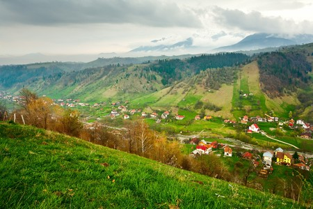 Landscape with a village in a valley between mountains under cloudy sky Stock Photo - 6910906