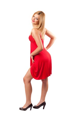 Full length portrait of a gorgeous pinup blond woman in red dress isolated on white photo