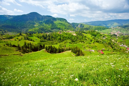 Beautiful alpine landscape with mountains and sky
