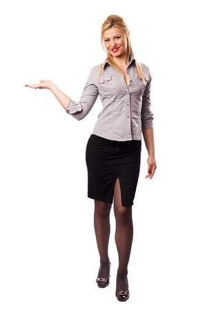 Attractive businesswoman in suit presenting an invisible product photo