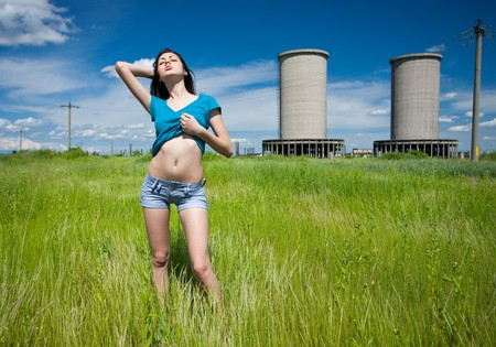 abandoned factory: Portrait of a beautiful young woman in an industrial background