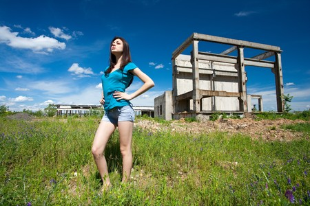 Portrait of a beautiful young woman in an industrial background photo
