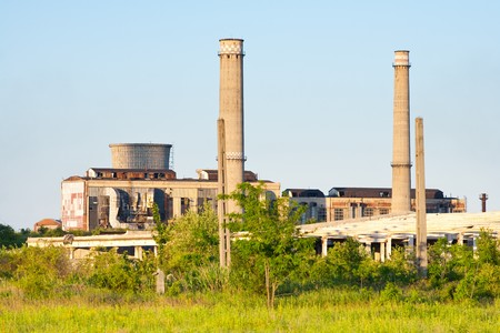 Landscape with abandoned industrial facilities under blue sky Stock Photo - 7137529