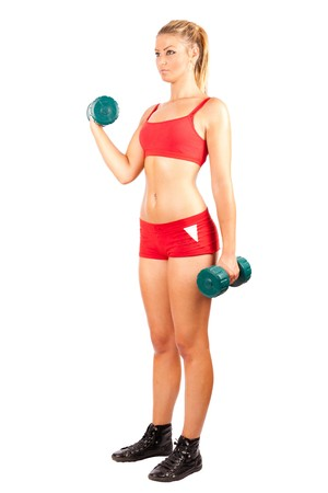 Young woman in red shorts and top doing workout with weights, isolated on white photo