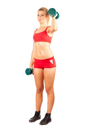 Young woman in red shorts and top doing workout with weights, isolated on white Stock Photo - 7337948