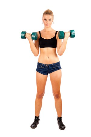 female bodybuilder: Athletic young lady doing workout with weights Stock Photo
