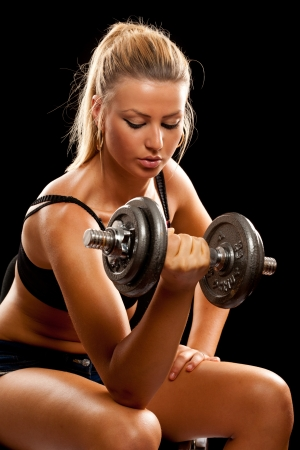 gym girl: Athletic young lady doing workout with weights Stock Photo