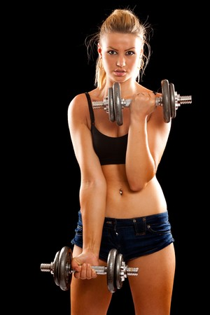 Athletic young lady doing workout with weights Stock Photo - 7233912