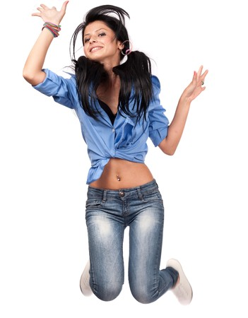 Cute teenage girl jumping for joy, isolated on white photo