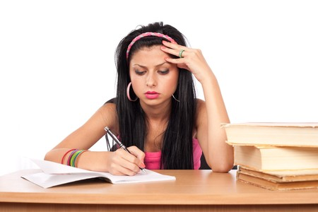 Portrait of a cute teenage girl at her desk Stock Photo - 7316788