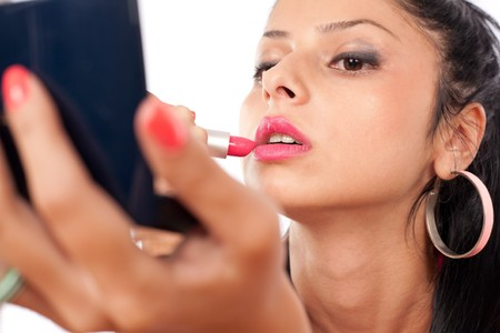 Close up of a beautiful brunette woman applying makeup Stock Photo - 7316820