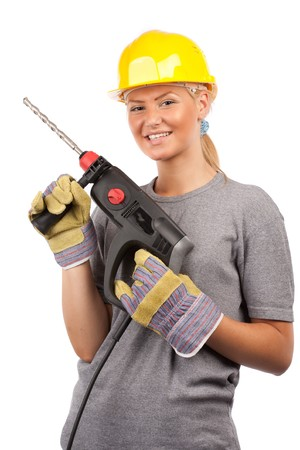 hand drill: Attractive young lady worker with a pneumatic drilling machine isolated on white Stock Photo