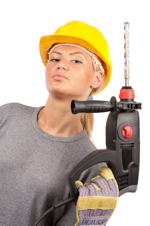 Attractive young lady worker with a pneumatic drilling machine isolated on white Stock Photo - 7365855