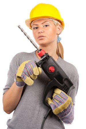 Attractive young lady worker with a pneumatic drilling machine isolated on white Stock Photo - 7365847