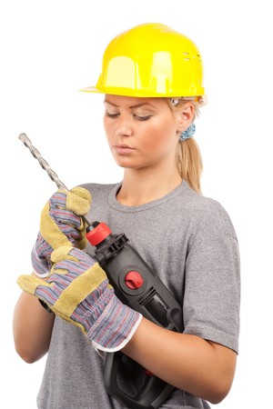 Attractive young lady worker with a pneumatic drilling machine isolated on white Stock Photo - 7365860