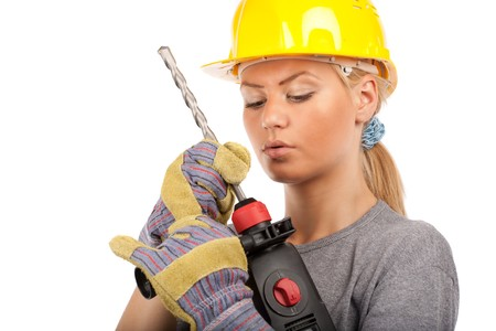 Attractive young lady worker with a pneumatic drilling machine isolated on white Stock Photo - 7365844