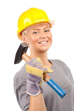 Attractive young lady worker with a hammer isolated on white photo