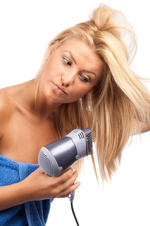 blow drier: Beautiful blonde woman using a hair drier, isolated on white