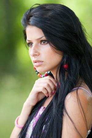 Close up portrait of a beautiful brunette woman outdoor photo