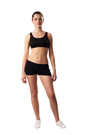 Young woman in black shorts and top doing aerobic, isolated on white background photo