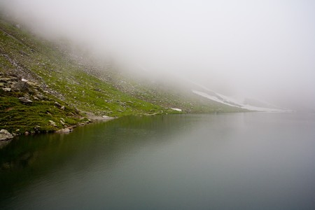 balea: Landscape of Balea Lake in Romania in a misty day