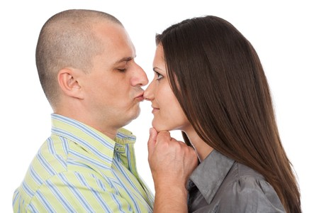 Man giving a kiss on the nose to his girlfriend photo