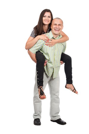 Happy young lady having a piggyback ride on her boyfriend's back Stock Photo - 7512661