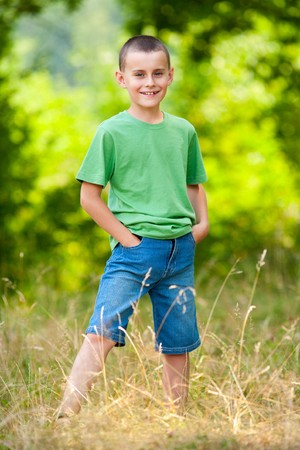 Portrait of a cute kid in a forest photo