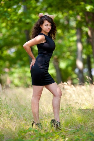 Full length portrait of a gorgeous young lady outdoor in the forest photo