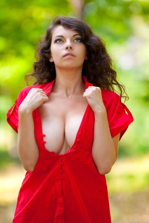 Portrait of a beautiful woman outdoor in the forest photo