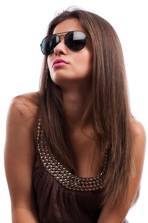 Close up portrait of young woman wearing stylish sunglasses isolated on white background photo