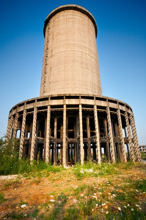 Landscape with abandoned industrial facilities under blue sky photo