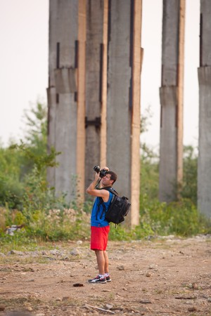 Photographer taking documentary pictures of a ruined industrial zone photo