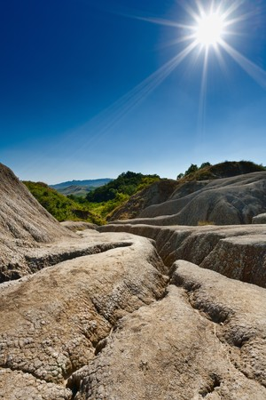Landscape with cracked soil from muddy volcanoes at Berca, Romania photo