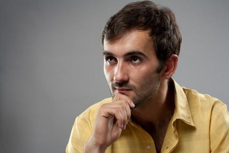 Close up portrait of a young man studio shot photo