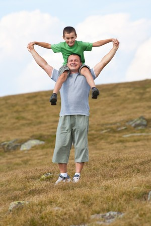 Father and son having a great time on a meadow Stock Photo - 7730867