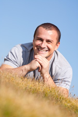 man outdoors: Portrait of a young man outdoor with sky in the background