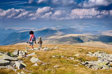 Mother and son having a great time together, traveling in the mountains photo