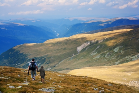 Father and son having a great time in the mountains Stock Photo - 7730914