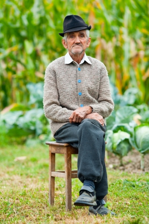 poor man: Portrait of a wrinkled and expressive old farmer outdoor